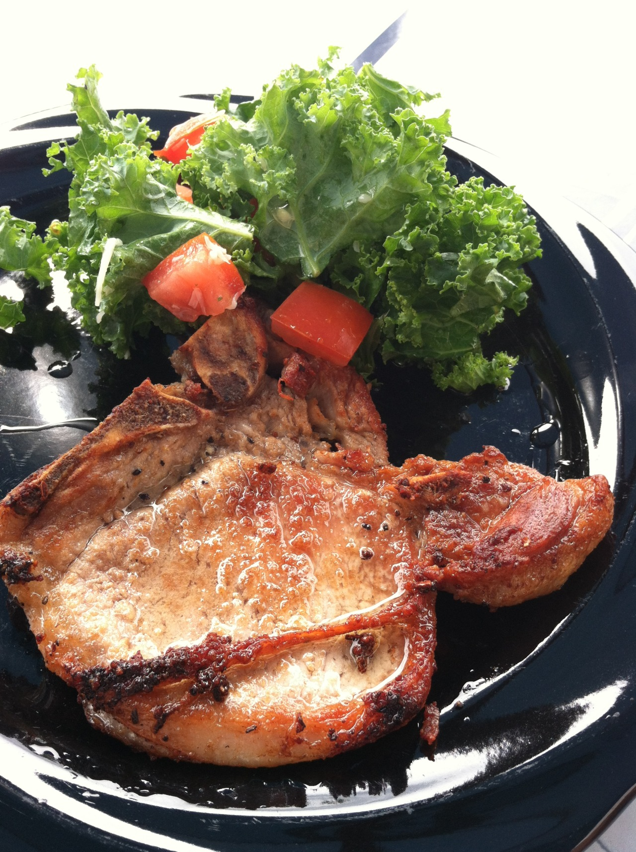 Pork Chop with Kale SaladFilipinos also eat crispy golden browned pork chop.
